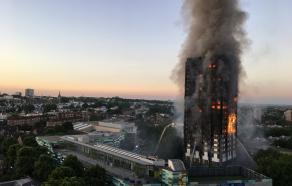 Grenfell Tower burning, pictured at 04:43 BST, 14 June 2017